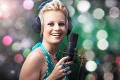 Woman singing on microphones Royalty Free Stock Photography