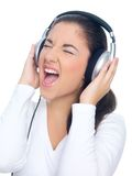 Woman Singing Out Loud While Listening to Music Stock Images