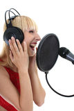 Woman singing over white Royalty Free Stock Photography