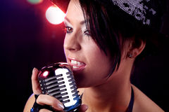 Woman  singing at the revelry party Royalty Free Stock Photography