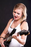 Woman singing rock song guitar isolated Royalty Free Stock Image