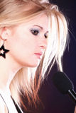 Woman singing rock song microphone Royalty Free Stock Photography