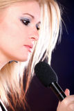 Woman singing rock song microphone Stock Image