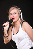 Woman singing rock song microphone Stock Photography