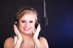 Woman singing rock song microphone headphones Stock Photo
