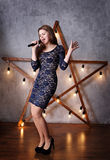 Woman singing on stage stock photography