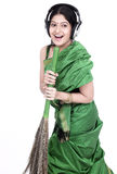 Woman singing and sweeping Royalty Free Stock Photos