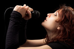 Woman Singing Tenderly Stock Images