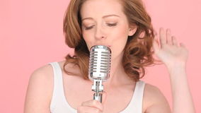 Woman Singing In To Microphone Royalty Free Stock Image