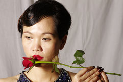 Woman and single red rose. Portrait of woman in the mood Royalty Free Stock Photography