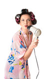 Woman sings karaoke on hair dryer Stock Photo