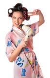 Woman sings karaoke on hair dryer Stock Photography