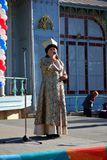 Woman sings the song. National Unity Day in Russia. Pyatigorsk, Russia - November 4, 2017: The woman sings the song on the stage in a traditional clothes of the Royalty Free Stock Photography