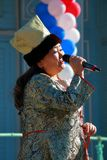 Woman sings the song. National Unity Day in Russia. Pyatigorsk, Russia - November 4, 2017: The woman sings the song on the stage in a traditional clothes of the Stock Photography