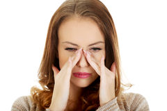 Woman with sinus pressure pain. Royalty Free Stock Image
