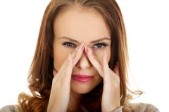 Woman with sinus pressure pain. Royalty Free Stock Photography