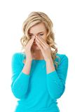 Woman with sinus pressure pain Stock Photo