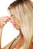 Woman with sinus pressure pain Stock Photography