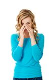 Woman with sinus pressure pain Royalty Free Stock Image