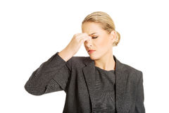 Woman with sinus pressure pain. Young woman with sinus pressure pain Royalty Free Stock Images