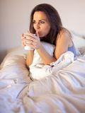 Woman Sipping Coffee While on Bed Royalty Free Stock Photography