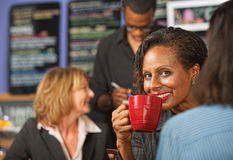Woman Sipping Coffee Stock Photo