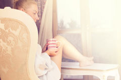Woman sipping coffee in a magic moment of quiet Royalty Free Stock Photos