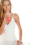 Woman sipping juice Royalty Free Stock Images