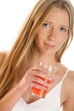Woman sipping juice Stock Photo