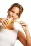 Woman sipping orange juice Royalty Free Stock Photo