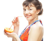 Woman sipping orange juice with a straw Royalty Free Stock Image