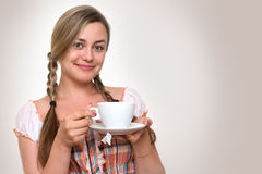 Woman  sipping tea Stock Images