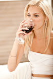 Woman sipping wine Royalty Free Stock Image