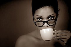 Woman Sips Coffee Royalty Free Stock Images