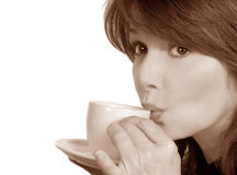 Woman Sips Her Tea Stock Images