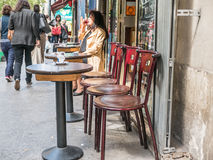 Woman sips wine at sidewalk cafe, Paris, France Stock Photography
