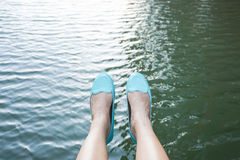Woman sit aside the river. Woman with green shoes sit aside the river Royalty Free Stock Images