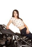 Woman sit backwards on motorcycle sit look back stock image