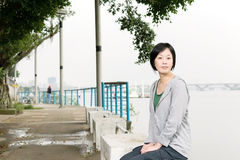 Woman sit on bench Royalty Free Stock Photography