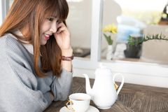 Woman sit in cafe with hot tea during brunch. asian female have. Woman sit in cafe with hot tea during brunch. beautiful asian female have a break in coffee shop Royalty Free Stock Photography