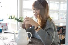 Woman sit in cafe with hot tea during brunch. asian female have. Woman sit in cafe with hot tea during brunch. beautiful asian female have a break in coffee shop Stock Photos