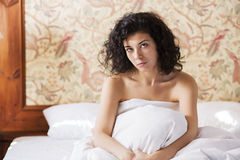 Woman sit calmly in bed after night Royalty Free Stock Photo