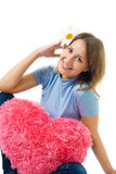 Woman sit with camomile and teddy red heart Royalty Free Stock Photography