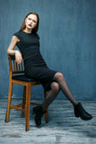 Woman sit on chair. Beautiful woman sit on chair Stock Photo