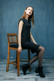 Woman sit on chair Stock Images