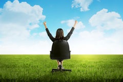 Woman Sit On Chair On Green Grass Stock Image