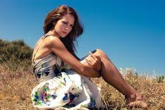 Woman sit in field Stock Image