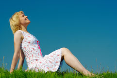 Woman sit on green grass Stock Photography