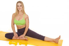 Woman sit green sports bra face Stock Photos