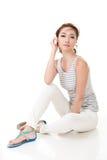 Woman sit on ground Stock Photo